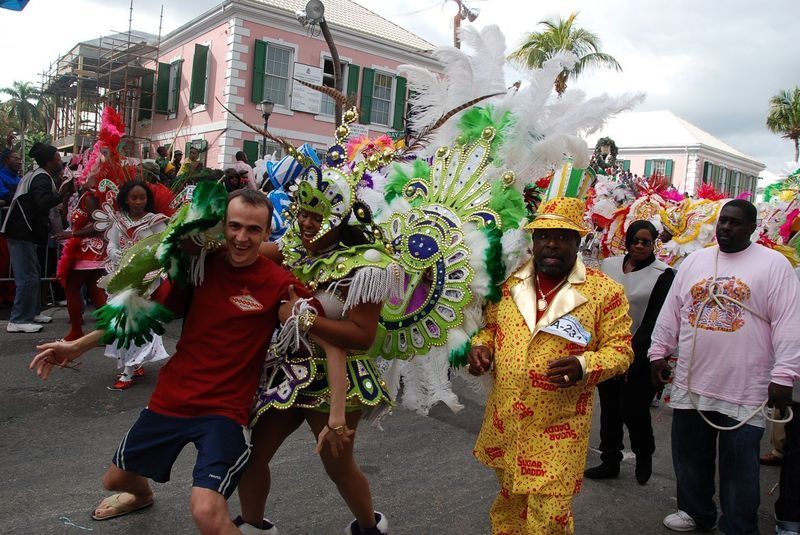 celebrating junkanoo in the bahamas as Junkanoo is a street parade with music, dance, and costumes of akan origin in many islands across the bahamas every boxing day (december 26) and new year's day (january 1), the same as kakamotobi or the fancy dress festival.